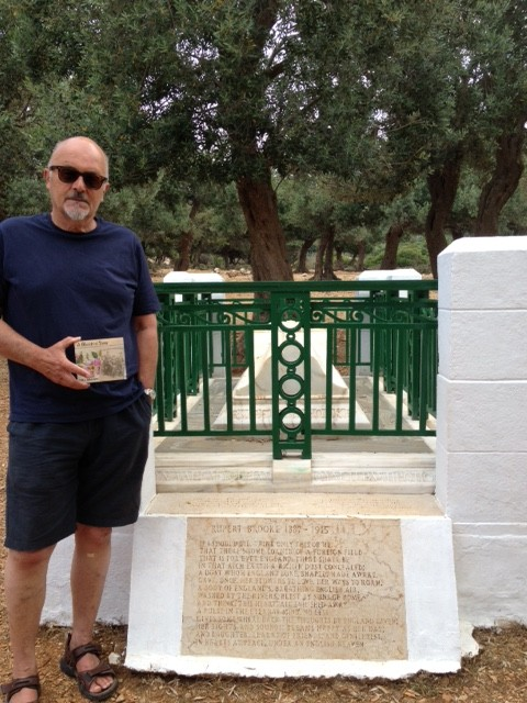 "Our own Chris Hardy leaves a copy of ""A Blackbird Sang"" on Rupert Brooke's tomb"